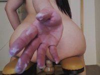 Sexy Asian rides and creams on a dildo rocker