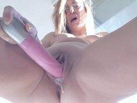 Blonde milf using her pink vibrator dildo and creaming