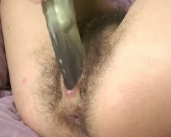 Euro girl with a hairy pink pussy uses her sex toy to masturbate